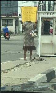 Woman With Placard Searching For Job For Her Husband In Lagos (Photo)
