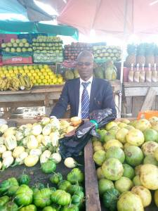Fruit seller seen wearing suit for his business….  See his touching reason