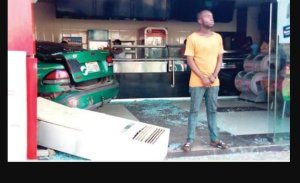VIO Officer Forces Taxi Driver To Crash Into Mr Bigg's Restaurant In Abuja (Photos)