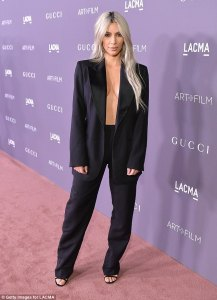 Kim Kardashian goes braless in pantsuit for event