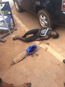 Young Man Reportedly Slumps After Vomiting In Front Of First Bank In Enugu (Photos)