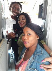 Passengers take photo with 25-year old female pilot (Photos)