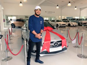 Nigerian Man Buys His Wife Mercedes Benz As Christmas Gift (Photos)