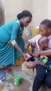 Nigerian Woman Dips Her Stepson's Hands Into Hot Water For Eating Her Food (Photos)