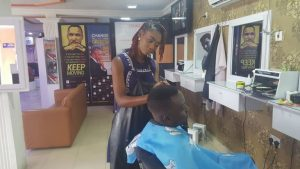 Female barber spotted in Lagos – (Photos)
