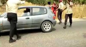 Watch as FRSC official beat up a woman with his belt on the road (Video)