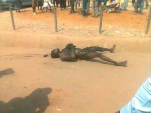 Motorcycle Thief Burnt By Mob In Abuja (Graphic Photos)
