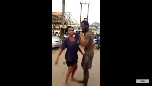See A Mad Man And Woman Dancing On The Road (Video)