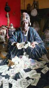 Check out this Native Doctor Posing With Dollars And Other Foreign Currencies (Photos)