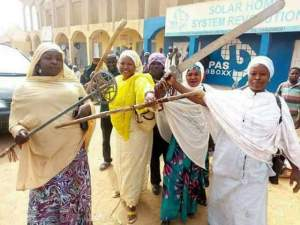 PHOTONEWS: Women Wearing Hijabs Pose With Weapons In Kano (Photo)
