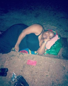 Lady and her workers sleep outside after working for a client outside (Photo)