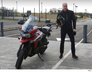 Prince Williams takes a ride on a Triumph Motorcycle as he inspects their facilities (Photos)