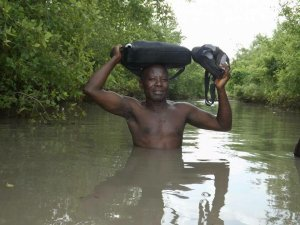 See this Togolese teacher going to school half naked on a flooded road, See reactions (Photo)