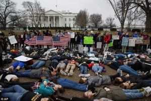 Students Staged Lie-in Protest In Front Of White House Over Gun Law Act (Photos)