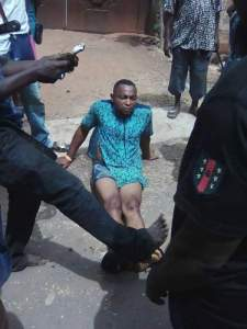 Man Caught After Robbing A Lady & Sales Girl With A Machete In Anambra (Photos)
