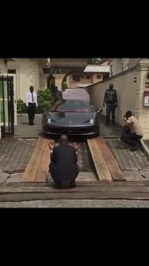 See how a Nigerian man drives out his Ferrari every morning (Video)