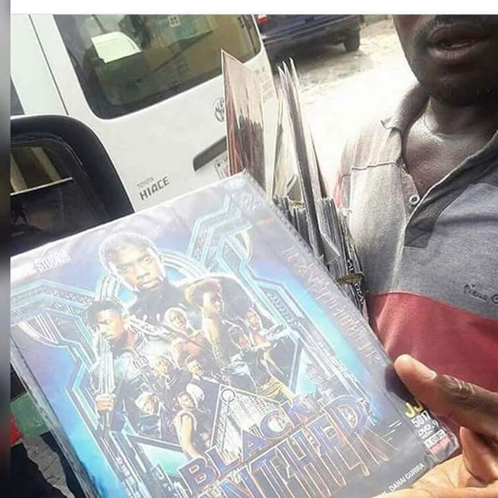 "See This Man Already Hawking ""Black Panther"" Movie In Lagos Traffic (Photo)"