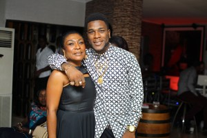 LOVELY: Watch as Burna Boy performs on stage with his mother; her dance moves are dope (Video)