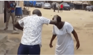 See as Pastor is beaten by mad woman as he was trying to deliver her (Video)