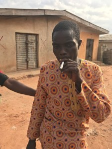 Man smokes his weed even as Police is arresting him (Photos)