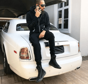 Check out Phyno chilling on his new Rolls Royce Phantom (Photo)
