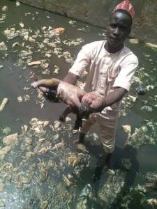 SAD: Dead Baby Found In A Gutter In Kano. (Graphic Photos)