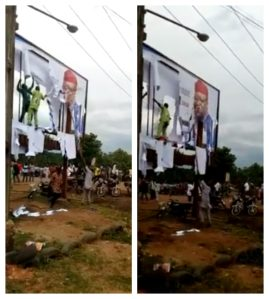 Gov.Fayose's Supporters Caught Tearing Down Campaign Posters Of APC Candidate, Kayode Fayemi (Video)