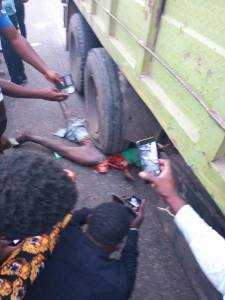 Man's Intestine Burst Out As He's Crushed To Death By A Truck In Lagos (Graphic Photos)