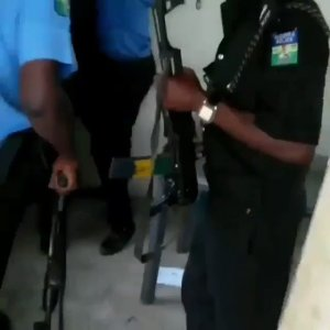 Watch disturbing video of Nigerian Police officers dragging a gun with a Civil Defence officer (Video)