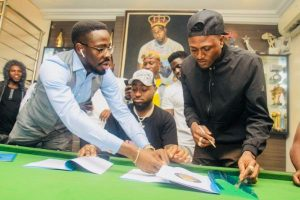 Davido Signs Idowest to DMW (Photo)