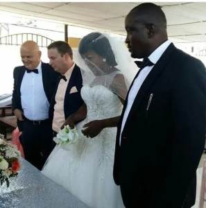 Angry 'side chick' disrupts wedding ceremony in bridal gown (Video)