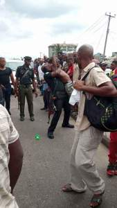 See what police officers did to a bus driver because of N50 bribe (Photos)
