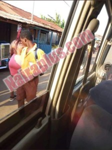 Check Out This Schoolboy Looking At A Lady's Big Backside (Photo)