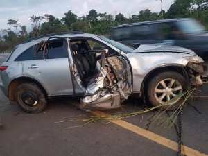 Man Survives Ghastly Accident, Climbs On His Damaged Vehicle To Take Pictures.