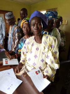 Some Beneficiaries Of Buhari's Social Investment Program Receiving Their 5,000 (Photos)