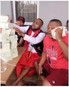 Check out stacks of money to be sprayed by Davido at a wedding in Owerri (Photos)