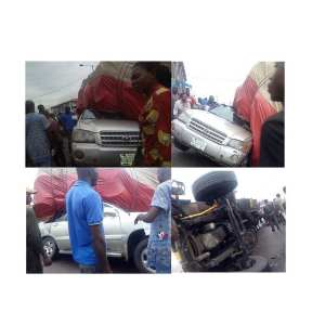 Father And Daughter Escape Death, As Truck Crushes Their SUV In Benin (Photos)
