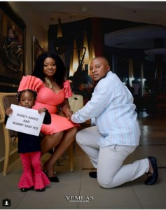 Man Kneels Down To Propose To His Baby Mama. (See Their Daughter's Reaction)
