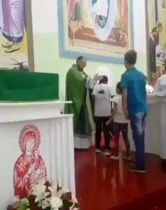 Rev. Father seen slapping small kids in church (Video)