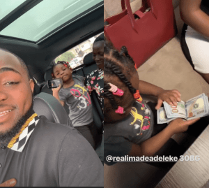 Davido's daughter, Imade seen playing with bundle of $100 bills