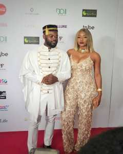 Yemi Alade Steps Out With Falz In Cleavage-Baring Outfit At #ChiefDaddyMovie Premiere (Photo)