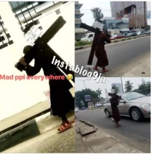 Man Carries A Cross In Lagos; Apologizes To Jesus For Sinning Against Him (Video)