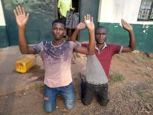 Two Men Thank God After Their Release From Prison In Onitsha