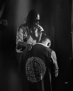 Adekunle Gold Kneels Down To Greet Asa As They Perform Together (Photo)
