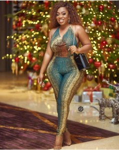 Ghanaian Actress, Moesha Boduong Shows Off Her Sexy Figure In Skinny Jumpsuit