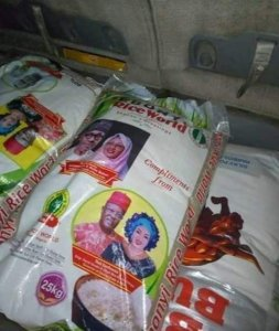 Hmmm: PDP Governor,  Umahi Pictured With President Buhari On Bags Of Rice (Photo)