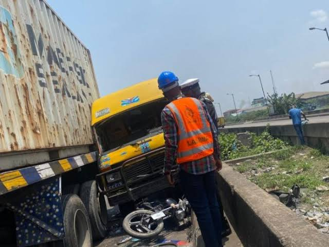 Another Truck Tragedy: One Feared Dead, as Truck Crush Bus, Bike In Lagos