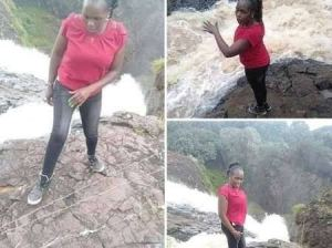 Lady slips into waterfall while posing for a photo