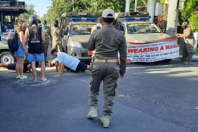 , Foreigners without face masks punished with push-ups in Indonesia, Effiezy - Top Nigerian News & Entertainment Website