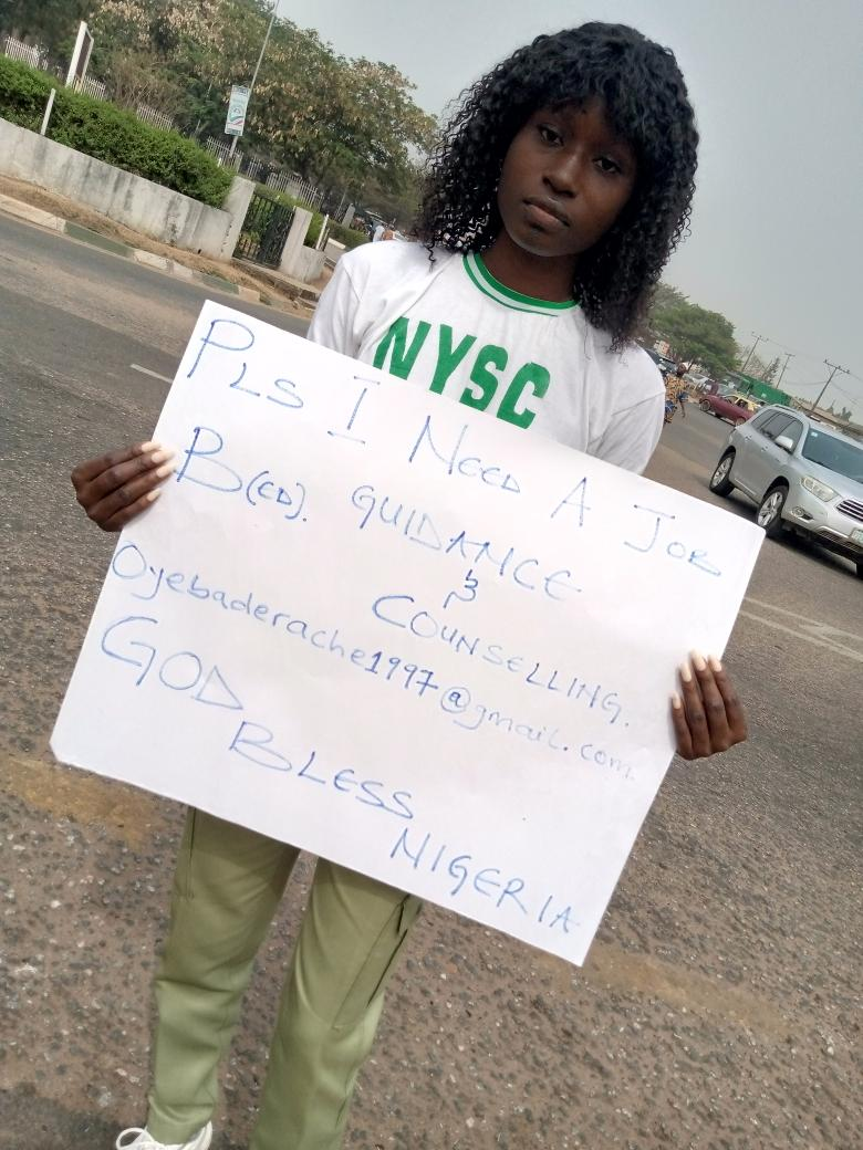 Graduate in NYSC uniform hits the street to beg for job immediately after passing out